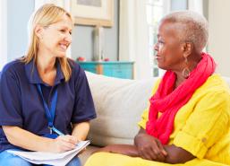 caregiver and elder woman talking