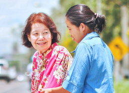 caregiver assisting elderly